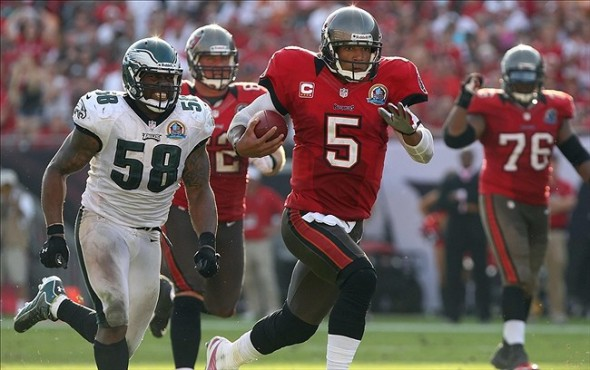 December 9, 2012; Tampa, FL, USA; Tampa Bay Buccaneers quarterback Josh Freeman (5) runs with the ball as Philadelphia Eagles defensive end Trent Cole (58) defends during the second half at Raymond James Stadium. The Eagles won 23-21. Mandatory Credit: Kim Klement-USA TODAY Sports