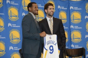 July 11, 2013; Oakland, CA, USA; Andre Iguodala (left) poses for a photo with Golden State Warriors general manager Bob Myers (right) in a press conference after a sign-and-trade deal for Iguodala to become a Golden State Warriors player at the Warriors Practice Facility. Mandatory Credit: Kyle Terada-USA TODAY Sports
