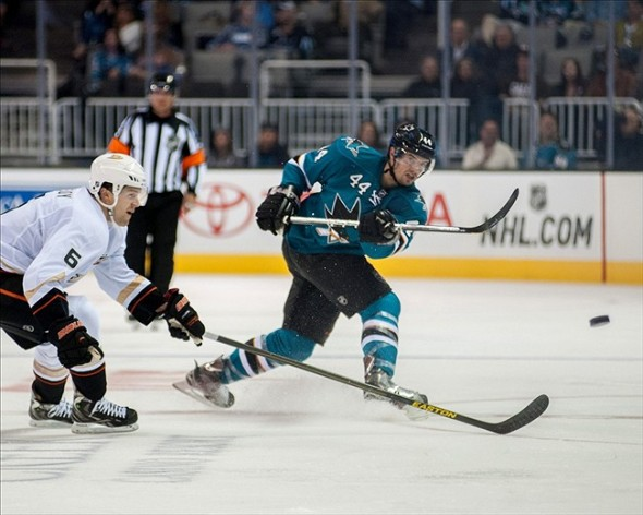 Sep 20, 2013; San Jose, CA, USA; San Jose Sharks defenseman Marc-Edouard Vlasic (44) clears the puck past Anaheim Ducks defenseman Ben Lovejoy (6) during the second period at the SAP Center at San Jose. Mandatory Credit: Ed Szczepanski-USA TODAY Sports