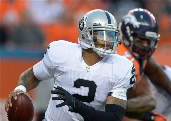 Sep 23, 2013; Denver, CO, USA; Oakland Raiders quarterback Terrelle Pryor (2) throws a pass against the Denver Broncos at Sports Authority Field at Mile High. Mandatory Credit: Kirby Lee-USA TODAY Sports