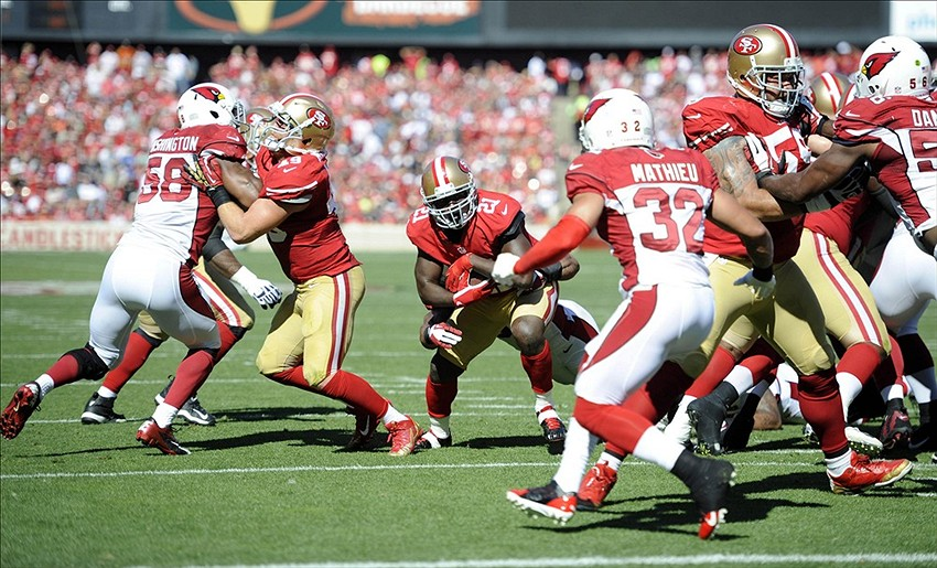Oct 13, 2013; San Francisco, CA, USA; San Francisco 49ers running back Frank Gore (21) runs for yardage during the second quarter in a game against the Arizona Cardinals at Candlestick Park. Mandatory Credit: Bob Stanton-USA TODAY Sports