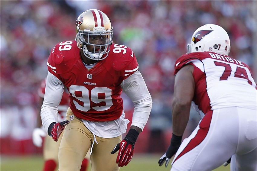 December 30, 2012; San Francisco, CA, USA; San Francisco 49ers outside linebacker Aldon Smith (99) tries to rush past Arizona Cardinals tackle D