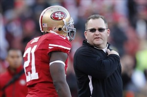 Jan 12, 2013; San Francisco, CA, USA; San Francisco 49ers offensive coordinator Greg Roman (right) talks to running back Frank Gore (21) before the NFC divisional round playoff game against the Green Bay Packers at Candlestick Park. Mandatory Credit: Cary Edmondson-USA TODAY Sports