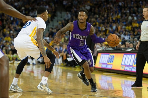 Nov 2, 2013; Oakland, CA, USA; Sacramento Kings shooting guard Ben McLemore (16) controls the ball against Golden State Warriors shooting guard Kent Bazemore (20) during the second quarter at Oracle Arena. Mandatory Credit: Kelley L Cox-USA TODAY Sports