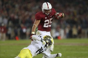 ]Nov 7, 2013; Stanford, CA, USA; Oregon Ducks cornerback Ifo Ekpre-Olomu (14) tackles Stanford Cardinal running back Tyler Gaffney (25) during the fourth quarter at Stanford Stadium. The Stanford Cardinal defeated the Oregon Ducks 26-20. Mandatory Credit: Kelley L Cox-USA TODAY Sports