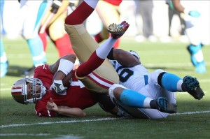 Nov 10, 2013; San Francisco, CA, USA; San Francisco 49ers quarterback Colin Kaepernick (7) is sacked by Carolina Panthers defensive end Greg Hardy (76) during the third quarter at Candlestick Park. The Carolina Panthers defeated the San Francisco 49ers 10-9. Mandatory Credit: Kelley L Cox-USA TODAY Sports