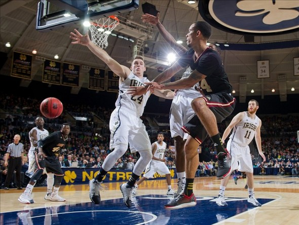 Nov 22, 2013; South Bend, IN, USA; Santa Clara Broncos guard Evan Roquemore (24) passes the ball as Notre Dame Fighting Irish guard Pat Connaughton (24) defends in the second half at the Purcell Pavilion. Notre Dame won 84-69. Mandatory Credit: Matt Cashore-USA TODAY Sports