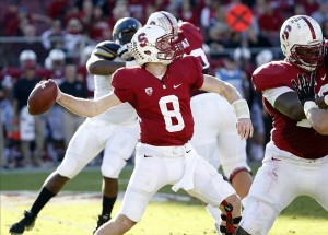 Nov 23, 2013; Stanford, CA, USA;Stanford Cardinal quarterback Kevin Hogan (8) throws a pass down field during the second quarter for a first down against the California Golden Bears at Stanford Stadium. Mandatory Credit: Bob Stanton-USA TODAY Sports