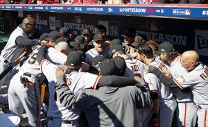 Oct 11, 2012; Cincinnati, OH, USA; San Francisco Giants right fielder Hunter Pence (center) huddles with his team prior to the game five of the 2012 NLDS against the Cincinnati Reds at Great American Ballpark. Mandatory Credit: Frank Victores-USA TODAY Sports
