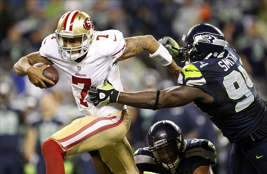 Sep 15, 2013; Seattle, WA, USA; San Francisco 49ers quarterback Colin Kaepernick (7) is tackled by Seattle Seahawks defensive tackle D