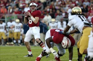 Nov 30, 2013; Stanford, CA, USA; Stanford Cardinal quarterback Kevin Hogan (8) looks for an open receiver against the Notre Dame Fighting Irish during the first quarter at Stanford Stadium. Mandatory Credit: Kelley L Cox-USA TODAY Sports