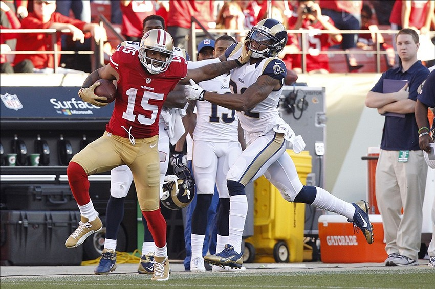 Dec 1, 2013; San Francisco, CA, USA; San Francisco 49ers wide receiver Michael Crabtree (15) tries to break free from the hold of St. Louis Rams cornerback Trumaine Johnson (22) after making a catch in the third quarter at Candlestick Park. The 49ers defeated the Rams 23-13. Mandatory Credit: Cary Edmondson-USA TODAY Sports