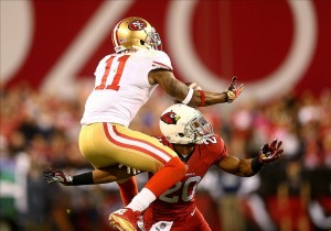 Dec 29, 2013; Phoenix, AZ, USA; San Francisco 49ers wide receiver Quinton Patton (11) catches a pass under pressure from Arizona Cardinals cornerback Antoine Cason (20) in the closing seconds of the game at University of Phoenix Stadium. The 49ers defeated the Cardinals 23-20. Mandatory Credit: Mark J. Rebilas-USA TODAY Sports