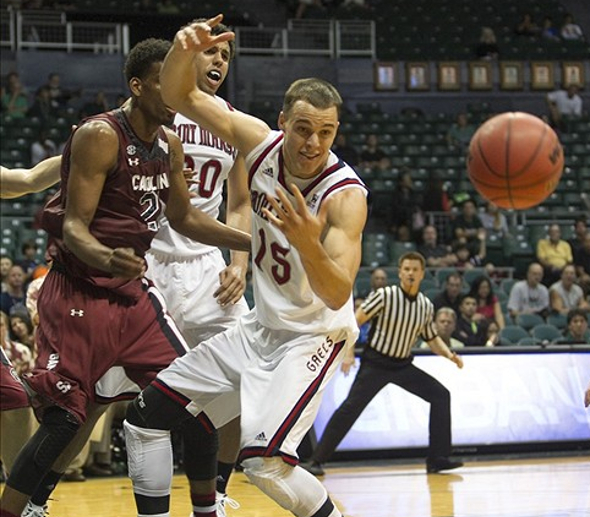 Dec 22, 2013; Honolulu, HI, USA; St. Mary's Gaels forward Beau Levesque (15) loses control of the ball against South Carolina Gamecocks during the first half of the game at the Stan Sheriff Center. Mandatory Credit: Marco Garcia-USA TODAY Sports