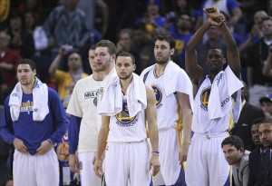 April 09, 2013; Oakland, CA, USA; Golden State Warriors bench of starters stand up for the final seconds of the game against the Minnesota Timberwolves during the fourth quarter at Oracle Arena. The Golden State Warriors defeated the Minnesota Timberwolves 105-89 to clinch a playoff berth. Mandatory Credit: Kelley L Cox-USA TODAY Sports