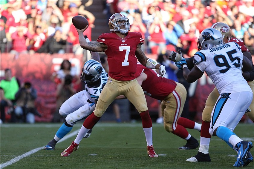 Nov 10, 2013; San Francisco, CA, USA; San Francisco 49ers quarterback Colin Kaepernick (7) throw the ball between pressure from the Carolina Panthers during the fourth quarter at Candlestick Park. The Carolina Panthers defeated the San Francisco 49ers 10-9. Mandatory Credit: Kelley L Cox-USA TODAY Sports