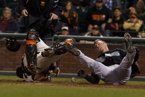 May 25, 2011; San Francisco, CA, USA; Florida Marlins center fielder Scott Cousins (right) collides with San Francisco Giants catcher Buster Posey (left) to score a run during the twelfth inning at AT&T Park. Mandatory Credit: Jason O. Watson-US PRESSWIRE