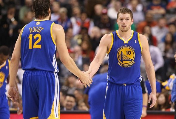Jan 28, 2013; Toronto, ON, Canada; Golden State Warriors forward David Lee (10) celebrates with center Andrew Bogut (12) against the Toronto Raptors at the Air Canada Centre. The Warriors beat the Raptors 114-102. Mandatory Credit: Tom Szczerbowski-USA TODAY Sports