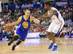 March 12, 2014; Los Angeles, CA, USA; Golden State Warriors guard Stephen Curry (30) moves the ball against Los Angeles Clippers center DeAndre Jordan (6) during the first half at Staples Center. Mandatory Credit: Gary A. Vasquez-USA TODAY Sports