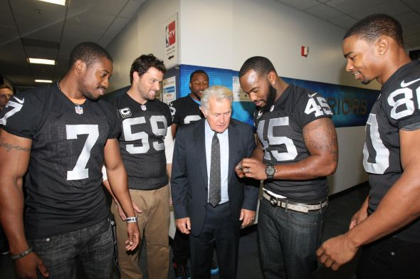 Marquette King, Jon Condo, Taiwan Jones, Marcel Reece and Rod Streater surround actor Martin Sheen during We Day at Oracle Arena. (TONY GONZALES/raiders.com)