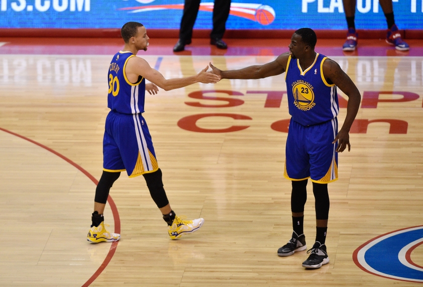 Apr 29, 2014; Los Angeles, CA, USA; Golden State Warriors guard Stephen Curry (30) celebrates with Golden State Warriors forward Draymond Green (23) after a foul is called during the game against the Los Angeles Clippers during the second quarter in game five of the first round of the 2014 NBA Playoffs at Staples Center. Mandatory Credit: Kelvin Kuo-USA TODAY Sports