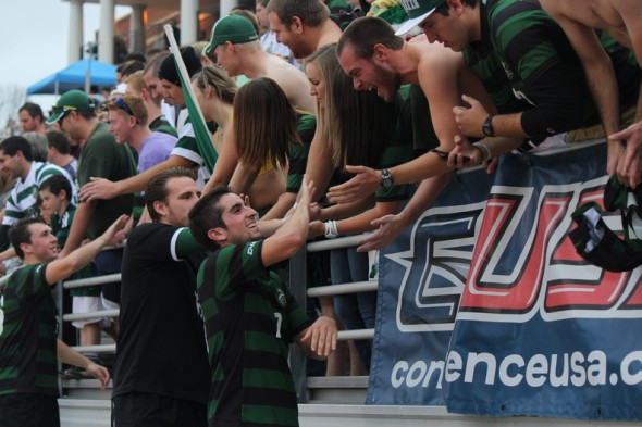 Players celebrate with fans after the Charlotte 49ers win their first Conference USA men's soccer championship. (photo courtesy Kevin Harbin)