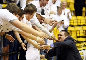 Jan 19, 2014; Hattiesburg, MS, USA; Southern Miss Golden Eagles head coach Donnie Tyndall celebrates with fans after defeating the Louisiana Tech Bulldogs 80-71 at Reed Green Coliseum. Mandatory Credit: Chuck Cook-USA TODAY Sports
