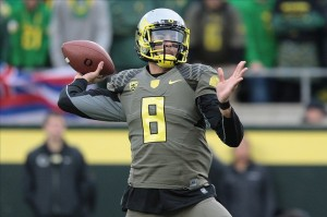 Nov 16, 2013; Eugene, OR, USA; Oregon Ducks quarterback Marcus Mariota (8) throws the ball against the Utah Utes at Autzen Stadium. The Ducks won 44-21. Mandatory Credit: Scott Olmos-USA TODAY Sports