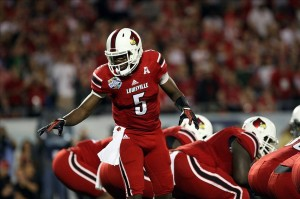 Dec 28, 2013; Orlando, FL, USA; Louisville Cardinals quarterback Teddy Bridgewater (5) gives instructions during the first quarter of the Russell Athletic Bowl against the Miami Hurricanes at Florida Citrus Bowl Stadium. Mandatory Credit: Rob Foldy-USA TODAY Sports