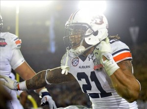 Jan 6, 2014; Pasadena, CA, USA; Auburn Tigers running back Tre Mason (21) celebrates his touchdown during the second half of the 2014 BCS National Championship game against the Florida State Seminoles at the Rose Bowl. Mandatory Credit: Gary A. Vasquez-USA TODAY Sports