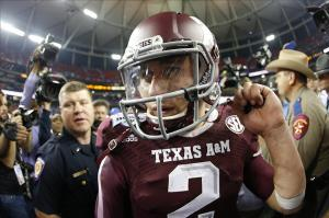 Dec 31, 2013; Atlanta, GA, USA; Texas A&M Aggies quarterback Johnny Manziel (2) celebrates defeating the Duke Blue Devils during the 2013 Chick-fil-A Bowl at the Georgia Dome. Texas A&M won 52-48. Mandatory Credit: Paul Abell-USA TODAY Sports