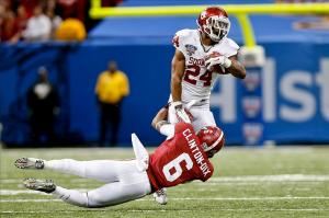 Jan 2, 2014; New Orleans, LA, USA; Alabama Crimson Tide defensive back Ha Ha Clinton-Dix (6) tackles Oklahoma Sooners running back Brennan Clay (24) during the fourth quarter of a game at the Mercedes-Benz Superdome. Oklahoma defeated Alabama 45-31. Mandatory Credit: Derick E. Hingle-USA TODAY Sports