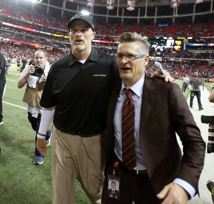 Sep 14, 2015; Atlanta, GA, USA; Atlanta Falcons head coach Dan Quinn (left) celebrates with general manager Thomas Dimitroff (right) following their 26-24 win over the Philadelphia Eagles at the Georgia Dome. Mandatory Credit: Jason Getz-USA TODAY Sports