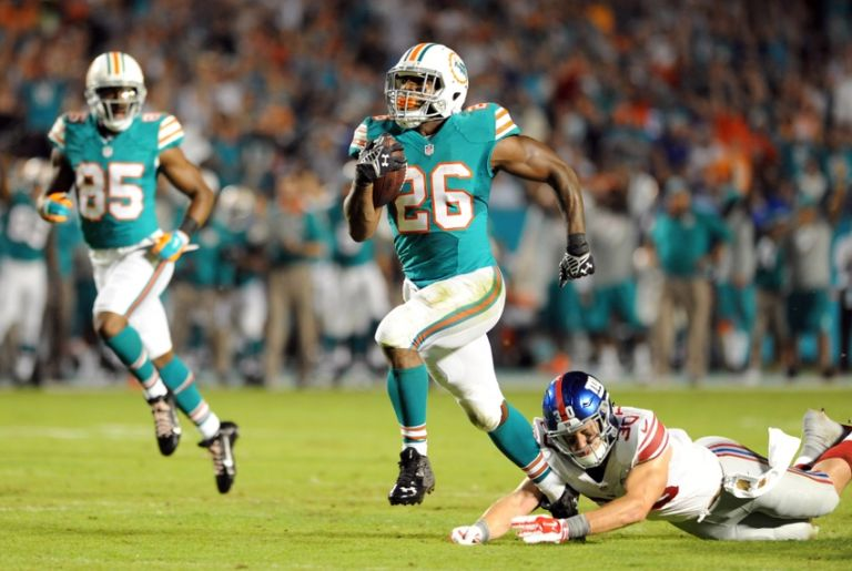 Lamar-miller-cooper-taylor-nfl-new-york-giants-miami-dolphins-1-768x0