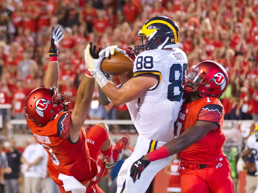 Sep 3, 2015; Salt Lake City, UT, USA; Michigan Wolverines tight end Jake Butt (88) catches a touchdown pass while defended by Utah Utes defensive back Jason Thompson (3) and defensive back Andre Godfrey (7) during the second half at Rice-Eccles Stadium. Utah won 24-17. Mandatory Credit: Russ Isabella-USA TODAY Sports