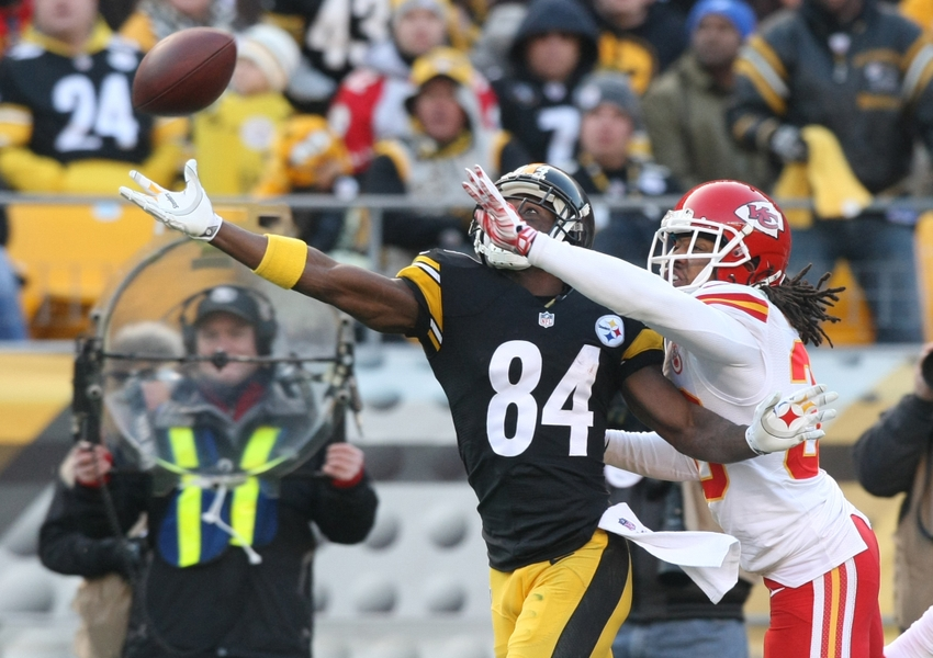 Dec 21, 2014; Pittsburgh, PA, USA; Pittsburgh Steelers wide receiver Antonio Brown (84) just misses a catch as he is guarded by Kansas City Chiefs cornerback Jamell Fleming (30) during the second half at Heinz Field. The Steelers won the game, 20-12. Mandatory Credit: Jason Bridge-USA TODAY Sports