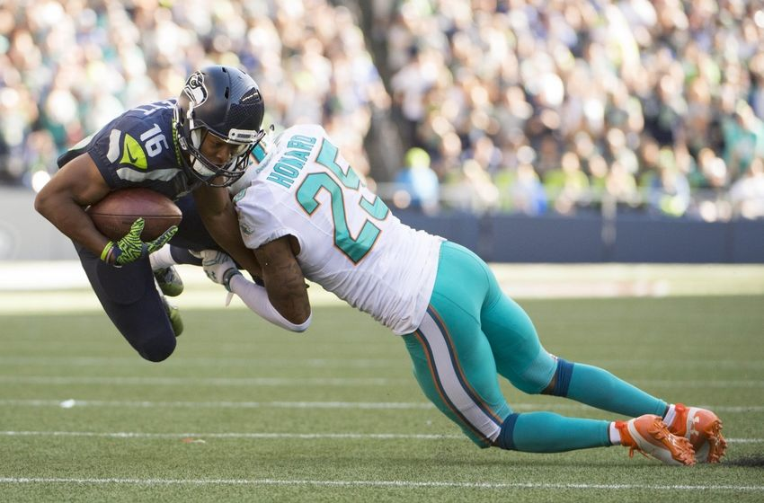 Sep 11, 2016; Seattle, WA, USA; Miami Dolphins cornerback Xavien Howard (25) tackles Seattle Seahawks wide receiver Tyler Lockett (16) during the fourth quarter at CenturyLink Field. The Seahawks won 12-10. Mandatory Credit: Troy Wayrynen-USA TODAY Sports