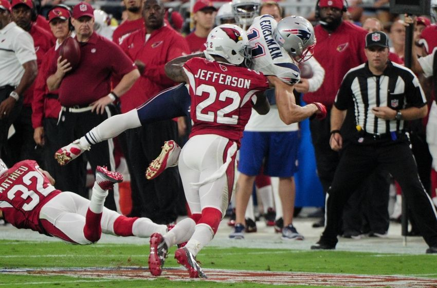Sep 11, 2016; Glendale, AZ, USA;  New England Patriots wide receiver Julian Edelman (11) is pushed out of bounds by Arizona Cardinals strong safety Tony Jefferson (22) during the first half at University of Phoenix Stadium. Mandatory Credit: Matt Kartozian-USA TODAY Sports