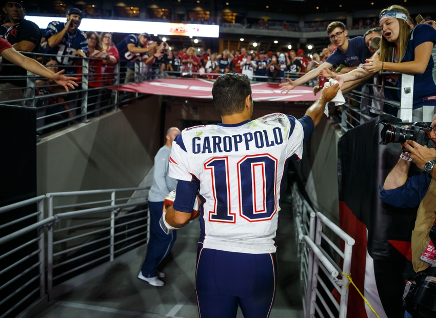 Sep 11, 2016; Glendale, AZ, USA; New England Patriots quarterback Jimmy Garoppolo (10) celebrates with fans as he leaves the field after defeating the Arizona Cardinals at University of Phoenix Stadium. The Patriots defeated the Cardinals 23-21. Mandatory Credit: Mark J. Rebilas-USA TODAY Sports
