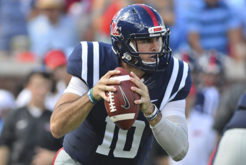 Sep 17, 2016; Oxford, MS, USA;  Mississippi Rebels quarterback Chad Kelly (10) runs the ball during the second quarter of the game against the Alabama Crimson Tide at Vaught-Hemingway Stadium. Mandatory Credit: Matt Bush-USA TODAY Sports
