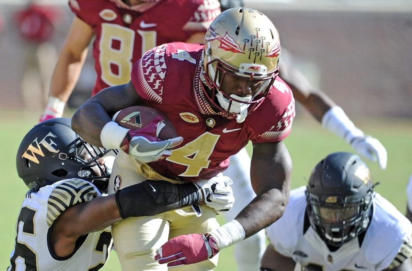 Oct 15, 2016; Tallahassee, FL, USA; Florida State Seminoles running back Dalvin Cook (4) runs past Wake Forest Demon Deacons linebacker Thomas Brown (26) during the game at Doak Campbell Stadium. Mandatory Credit: Melina Vastola-USA TODAY Sports