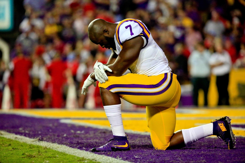 Oct 22, 2016; Baton Rouge, LA, USA; LSU Tigers running back Leonard Fournette (7) kneels prior to kickoff of a game against the Mississippi Rebels at Tiger Stadium. Mandatory Credit: Derick E. Hingle-USA TODAY Sports