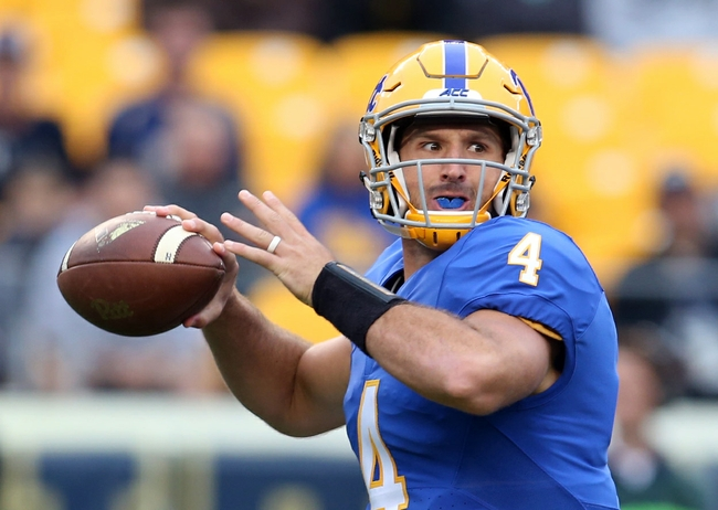 Oct 8, 2016; Pittsburgh, PA, USA; Pittsburgh Panthers quarterback Nathan Peterman (4) passes the ball against the Georgia Tech Yellow Jackets during the first quarter at Heinz Field. Mandatory Credit: Charles LeClaire-USA TODAY Sports