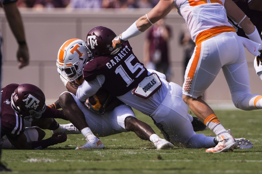 Oct 8, 2016; College Station, TX, USA; Texas A&M Aggies defensive lineman Myles Garrett (15) tackles Tennessee Volunteers quarterback Joshua Dobbs (11) during the first quarter at Kyle Field. Mandatory Credit: Jerome Miron-USA TODAY Sports
