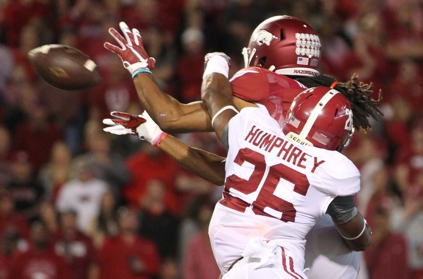Oct 8, 2016; Fayetteville, AR, USA; Arkansas Razorbacks wide receiver Keon Hatcher (4) catches a pass for a touchdown as Alabama Crimson Tide defensive back Marlon Humphrey (26) defends during the second quarter at Donald W. Reynolds Razorback Stadium. Mandatory Credit: Nelson Chenault-USA TODAY Sports