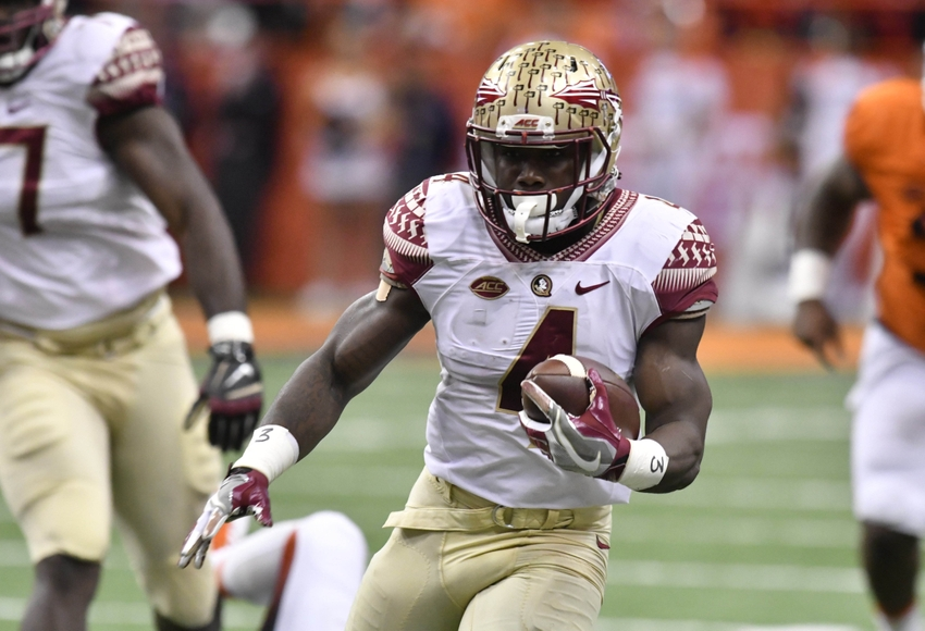 Nov 19, 2016; Syracuse, NY, USA; Florida State Seminoles running back Dalvin Cook (4) carries the ball during the first quarter of a game against the Syracuse Orange at the Carrier Dome. Mandatory Credit: Mark Konezny-USA TODAY Sports