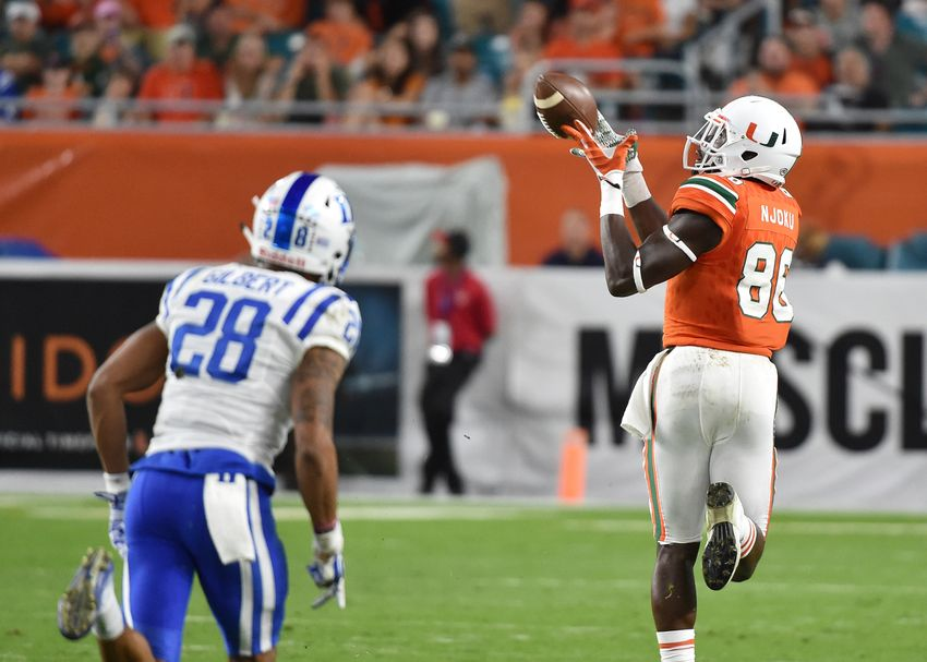 Nov 26, 2016; Miami Gardens, FL, USA; Miami Hurricanes tight end David Njoku (86) hauls in a touchdown catch in front of Duke Blue Devils cornerback Mark Gilbert (28) during the second half at Hard Rock Stadium. Miami won 40-21. Mandatory Credit: Steve Mitchell-USA TODAY Sports