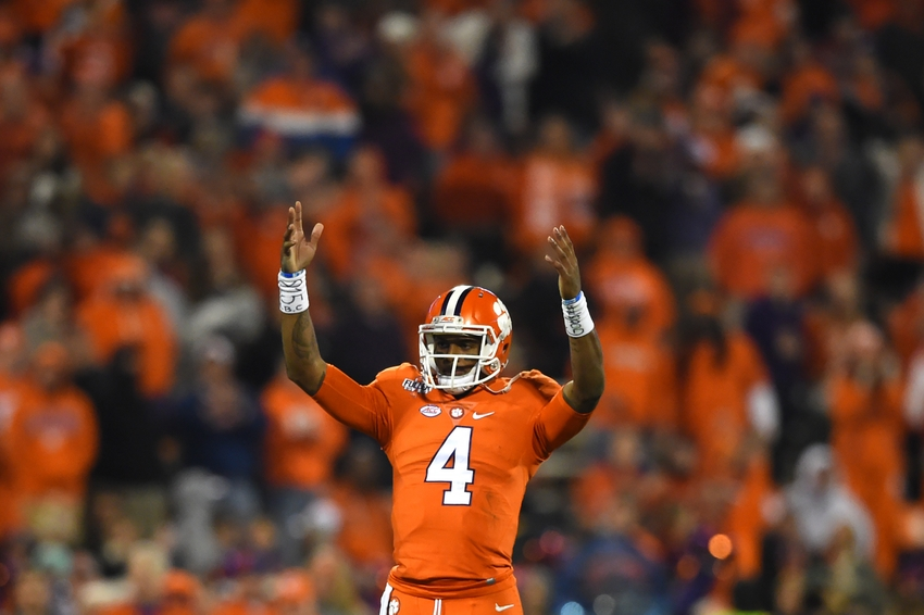 Nov 26, 2016; Clemson, SC, USA; Clemson Tigers quarterback Deshaun Watson (4) waves to the fans as he stands on the field during the fourth quarter against the South Carolina Gamecocks at Clemson Memorial Stadium. Clemson Tigers defeated South Carolina Gamecocks 56-7. Mandatory Credit: Tommy Gilligan-USA TODAY Sports