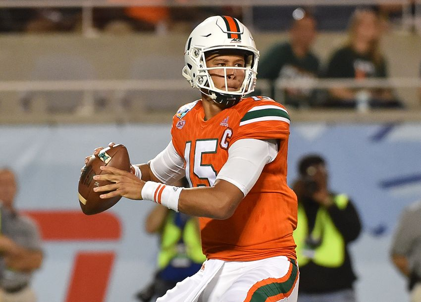 Dec 28, 2016; Orlando, FL, USA; Miami Hurricanes quarterback Brad Kaaya (15) attempts a pass against the West Virginia Mountaineers during the first half at Camping World Stadium. Mandatory Credit: Jasen Vinlove-USA TODAY Sports