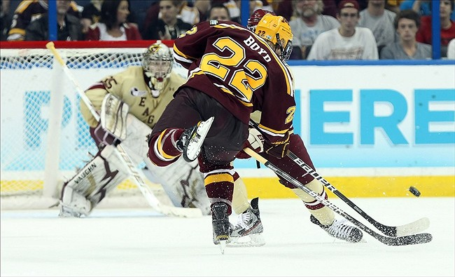 Apr 5, 2012; Tampa, FL, USA; Minnesota Gophers center Travis Boyd (22) shoots as Boston College Eagles goalie Parker Milner (35) defends in the second period during the semifinals of the 2012 Frozen Four at Tampa Bay Times Forum. Kim Klement-US PRESSWIRE